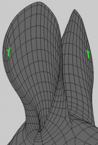 On this rabbit model, an acceptable T-vertex forms where the edge flow up the side of the ear meets the edge flow across the top of the ear.
